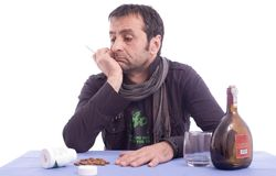 Sad looking man sitting at the table Royalty Free Stock Images