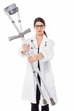 Sad looking medical expert holding up the crutches Stock Image