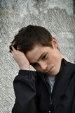 Teenage boy with big problems. Sad looking  teenager boy  with  big problems feeling alone Royalty Free Stock Photo