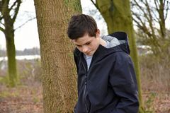 Teenage boy with big problems. Sad looking  teenager boy  with  big problems feeling alone Stock Images