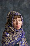 Sad looking woman wrapped in shawl Stock Image