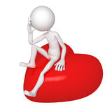 Sad lover sitting on red heart Stock Photos