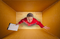 Sad mail courier inside empty box Royalty Free Stock Photos