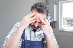 Sad male fitter having headache. Or feeling sorrow inside the house Stock Image