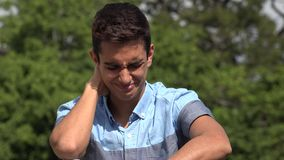 Sad Male Hispanic Teenager. A handsome hispanic male teen stock video