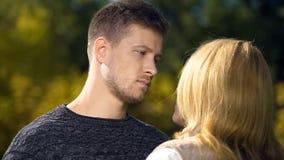 Sad male looking at female, relationship crisis, miscommunication problem royalty free stock image