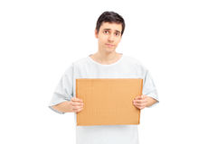 Sad male patient holding a piece of cardboard Stock Photography