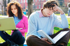 Sad male student at the park. Sad male student with a girl on a background at the park Stock Photography