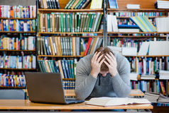 Sad male student in the university library Stock Photography