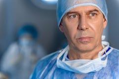 Sad male surgeon glancing despondently royalty free stock photography