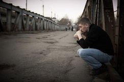 Sad man. Portrait of sad man on destroyed street Stock Photography
