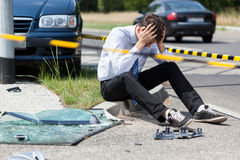 Sad man at accident scene Stock Photography