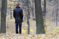 Sad man admiring nature. Lonely young business man suffering in forests , fall season Royalty Free Stock Images