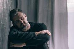 Sad man during autumn weather Stock Image
