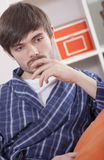 Sad man in bathrobe Royalty Free Stock Photography