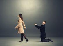 Sad man bending before woman Royalty Free Stock Photography