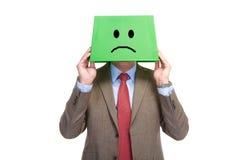 Sad man with a box on a head Stock Photo