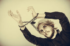 Sad man with chained hands, no freedom Stock Photos