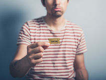 Sad man with cinema ticket Stock Image