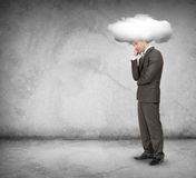 Sad man with cloud above head, looking down Royalty Free Stock Photography