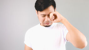 Sad man crying like a chlid. Royalty Free Stock Photography