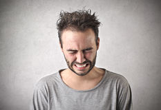 Sad man crying. Young sad man crying with a desperate expression Stock Photography