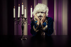 Sad, man dressed in rococo style, concept of wealth and poverty. Royalty Free Stock Photo