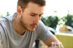 Sad man drinking in a bar Royalty Free Stock Images