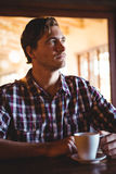 Sad man drinking a coffee Stock Images