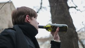 Sad man drowning grief in wine, problem of addiction to alcohol, depression. Stock footage stock video footage