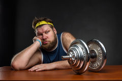 Sad man with a dumbbell Royalty Free Stock Image
