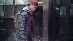 Sad man experienced stress and descends in the elevator in the subway. Sad man experienced stress received unpleasant news and descends in the elevator in the stock video