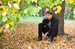 Sad man in fall. Background Royalty Free Stock Photo