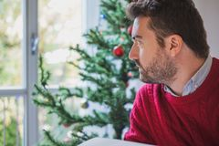 Sad man feeling bad during christmas days royalty free stock photos