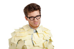 Sad man with a glasses covered with yellow sticky notes Royalty Free Stock Photos