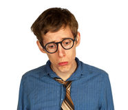 Sad Man with Glasses and Tie. Sad man with glasses, shirt and tie looking down and pouting, isolated on white background Royalty Free Stock Photos
