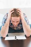 Sad man with hands on his head looking ripped paper Stock Images