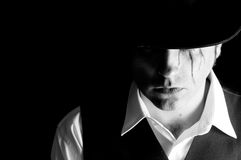 Sad man with hat. Portrait of a sad man with hat on black background Stock Images
