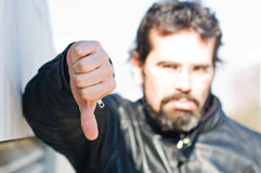 Sad man with his thumb down Stock Images