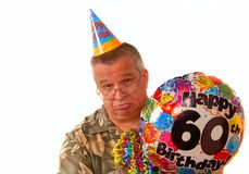 Sad man holding a balloon for a 60th birthday part Stock Image