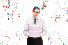 Sad man holding a birthday cake and crying Stock Photography