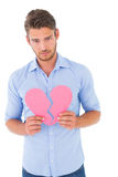 Sad man holding a broken heart Stock Photos