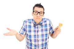Sad man holding an empty ice cream cone Royalty Free Stock Images