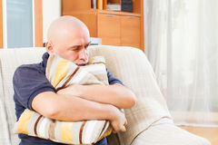 Sad man  at  home Stock Image