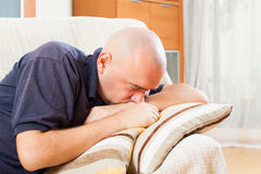Sad man at home Stock Photography