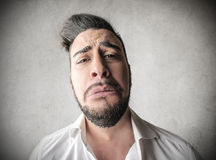 Sad man with a huge face. Sad desperate man with a huge face Royalty Free Stock Image