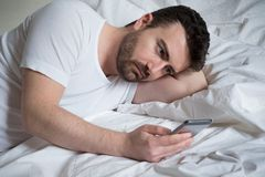Man reading bad news even in morning on the phone Stock Photos