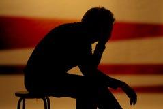 Sad man. A man locked in his sad thoughts Stock Photos