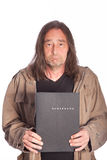 Sad Man with Long Hair Holding Folder Stock Images