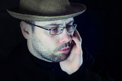 Sad man look. Portrait of man with hat and beard sad looking